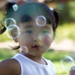 girl_blowing_bubbles photo